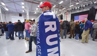Chris Landcastle of Westmoreland, N.Y., waits for a rally to begin for Republican presidential candidate Donald Trump at Griffiss International Airport, Apr. 12, 2016, in Rome, N.Y. (Mark DiOrio/Observer-Dispatch via AP)
