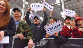 Supporters of Republican presidential candidate Donald Trump attend a rally at Griffiss International Airport, Tuesday, April 12, 2016 in Rome, N.Y. (Mark DiOrio/Observer-Dispatch via AP)