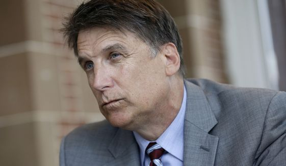 North Carolina Gov. Pat McCrory makes remarks during an interview at the Governor's mansion in Raleigh, N.C., Tuesday, April 12, 2016. McCrory says he wants to change a new state law that prevents people from suing over discrimination in state court, but he's not challenging a measure regarding bathroom access for transgender people. (AP Photo/Gerry Broome)