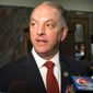 Louisiana Gov. John Bel Edwards talks with reporters about his budget cut proposal for the upcoming fiscal year after speaking to the House Appropriations Committee, Tuesday, April 12, 2016, in Baton Rouge, La.  (AP Photo/Melinda Deslatte)