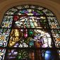 This April 5, 2016, file photo shows the detail of a stained glass window in Our Lady of Mount Carmel church in the Belmont area of the Bronx borough of New York. The church is on 187th Street in the Bronx near Arthur Avenue, in an area known for Italian food and culture. (AP Photo/Beth J. Harpaz)