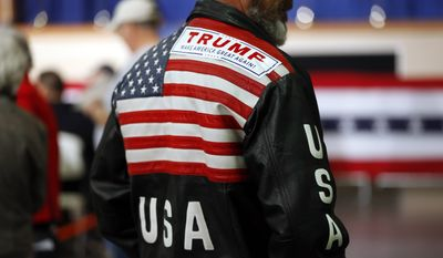 An audience member wears a Donald Trump sticker on his leather jacket during campaign stop on Feb. 18 in Gaffney, S.C. (Associated Press)