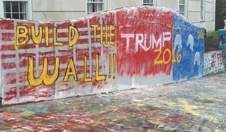 Students at Ohio University spray painted a pro-Trump message on a 'free speech wall' on campus. (Image: Twitter)