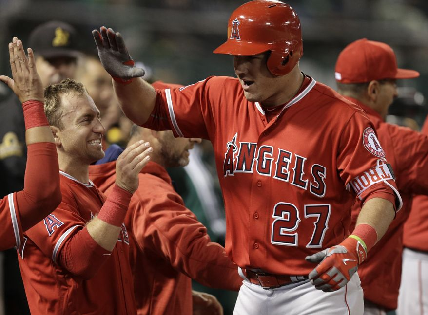 Los Angeles Angels' Mike Trout (27) celebrates after hitting a two run home run off Oakland Athletics' Sonny Gray in the sixth inning of a baseball game Monday, April 11, 2016, in Oakland, Calif. (AP Photo/Ben Margot)