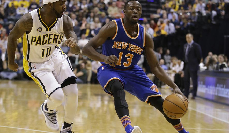 New York Knicks' Jerian Grant (13) goes to the basket against Indiana Pacers' Ty Lawson (10) during the first half of an NBA basketball game Tuesday, April 12, 2016, in Indianapolis. (AP Photo/Darron Cummings)