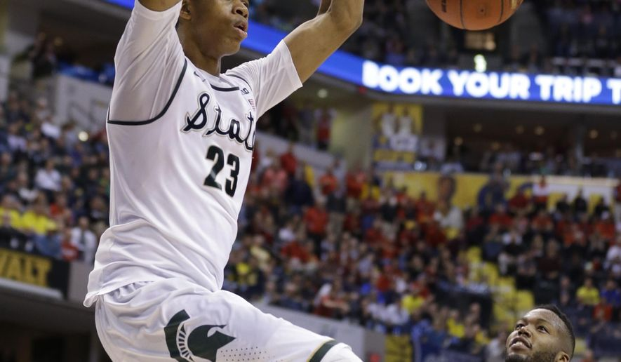 FILE - In this March 12, 2016, file photo, Michigan State's Deyonta Davis (23) dunks as Maryland's Robert Carter (4) watches in the second half of an NCAA college basketball game during the semifinals of the Big Ten Conference tournament in Indianapolis. Deyonta Davis is entering NBA draft after one season at Michigan State. The school announced his decision Tuesday, April 12, 2016. (AP Photo/Michael Conroy, File)