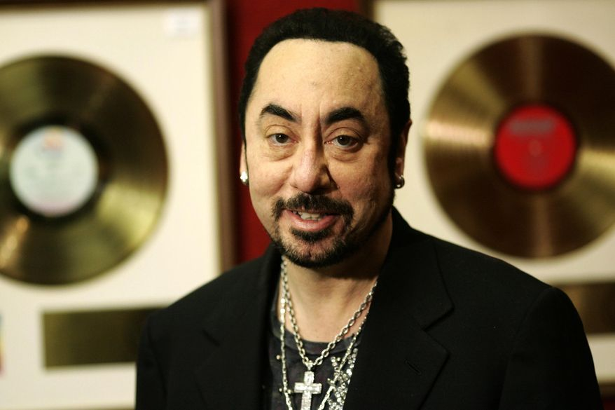 FILE - In this Wednesday, Nov. 21, 2007 file photo, U.S. music producer David Gest poses with some of his collection of entertainment memorabilia at an auction house in London. Music producer David Gest, ex-husband of Liza Minnelli, died Tuesday, April 12, 2016 at 62. (AP Photo/Sang Tan, file)