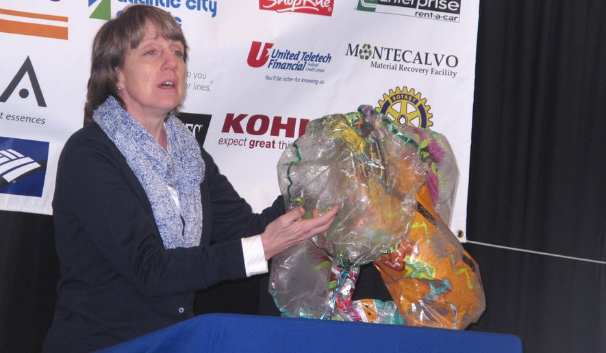 Cindy Zipf, executive director of the Clean Ocean Action environmental group, displays balloons collected from New Jersey beaches during cleanups last year. The baloons are lethal to marine life, particularly turtles that eat them, mistaking them for jellyfish. The group ran cleanups in which volunteers collected more than 332,000 pieces of trash last year. (AP Photo/Wayne Parry)