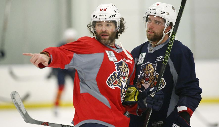 Florida Panthers right wing Jaromir Jagr, left, talks with defenseman Aaron Ekblad during a practice session, Tuesday, April 12, 2016, at the Panthers' practice facility in Coral Springs, Fla.  The Panthers take on the New York Islanders in Game 1 in the first round of the playoffs on Thursday at Florida. (AP Photo/Wilfredo Lee)