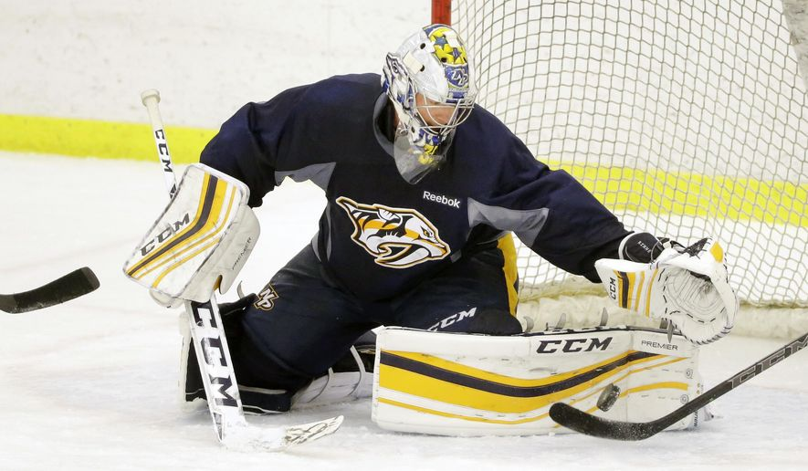Nashville Predators goalie Pekka Rinne, of Finland, practices Tuesday, April 12, 2016, in Nashville, Tenn. The Predators are scheduled to play the Anaheim Ducks in the first round of the NHL Western Conference hockey playoffs Friday. (AP Photo/Mark Humphrey)