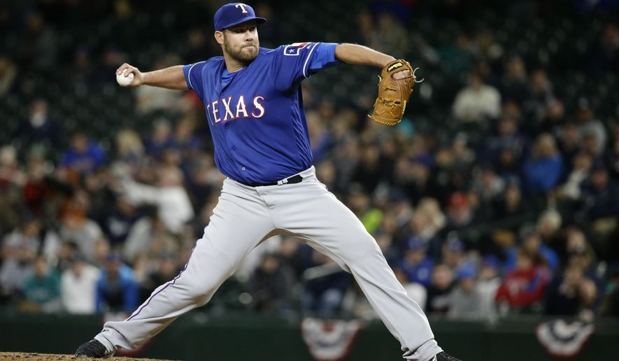Texas Rangers starting pitcher Colby Lewis throws against the Seattle Mariners in the sixth inning of a baseball game, Monday, April 11, 2016, in Seattle. (AP Photo/Ted S. Warren)