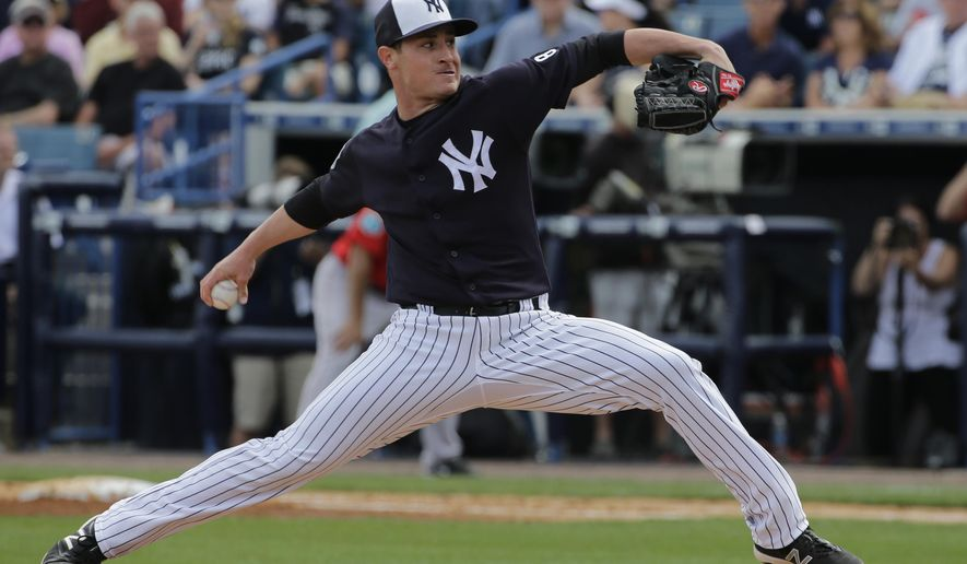 FILE - In this March 5, 2016, file photo, New York Yankees relief pitcher Nick Rumbelow delivers to the Boston Red Sox during a spring training baseball game in Tampa, Fla. Yankees reliever Nick Rumbelow has a torn elbow ligament and needs Tommy John surgery that will sideline him until next year. New York said the 24-year-old right-hander was injured Sunday while pitching for Triple-A Scranton/Wilkes-Barre at Rochester.(AP Photo/Chris O'Meara)