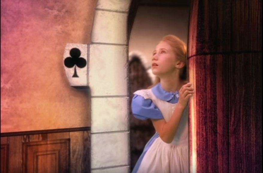 A new ad from gun control group, The Brady Campaign to Prevent Gun Violence, features Alice in Wonderland wandering through a corridor where she finds a gun inside a cabinet, and accidentally shoots herself. (Image: Screenshot YouTube).