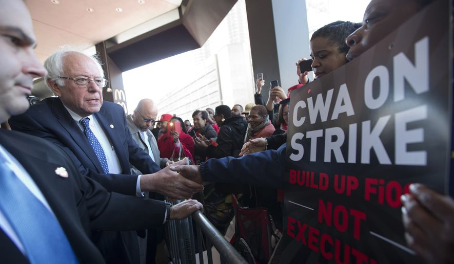Democratic presidential candidate, Sen. Bernie Sanders, I-Vt., greets a CWA worker at  a Verizon workers picket line, Wednesday, April 13, 2016, in the Brooklyn borough of New York. (AP Photo/Mary Altaffer)
