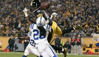 Indianapolis Colts cornerback Greg Toler (28) breaks up a pass intended for Pittsburgh Steelers wide receiver Martavis Bryant (10) during the first half of an NFL football game, Sunday, Dec. 6, 2015, in Pittsburgh. (AP Photo/Don Wright)