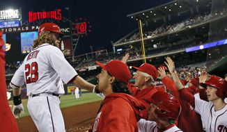 Washington Nationals' Jayson Werth (28) celebrates his two-run homer with his teammates during the fourth inning of a baseball game against the Atlanta Braves at Nationals Park, Wednesday, April 13, 2016, in Washington. (AP Photo/Alex Brandon)