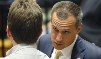 Donald Trump's campaign manager, Corey Lewandowski, talks to a member of the media at Nathan Hale High School in West Allis, Wisconsin, on April 3. (Associated Press) ** FILE **