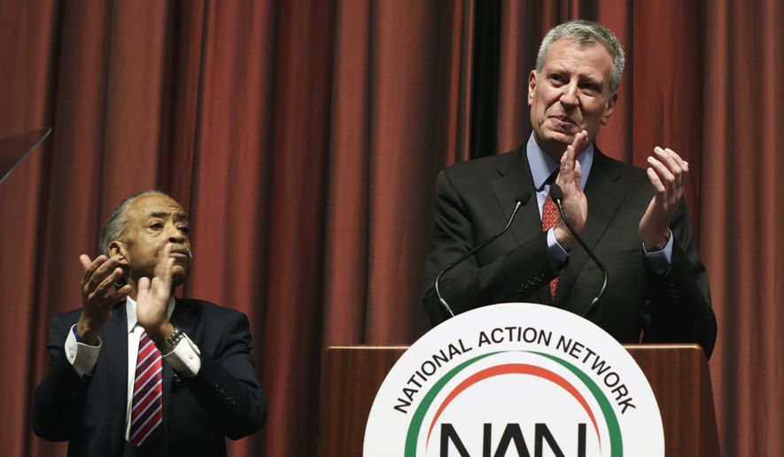 The Rev. Al Sharpton, left, and New York Mayor Bill de Blasio applaud during opening ceremonies of the 25th annual National Action Network convention, in New York, Wednesday, April 13, 2016. (AP Photo/Richard Drew)
