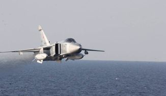 In this Tuesday, April 12, 2016, file photo provided by the U.S. Navy, a Russian Sukhoi Su-24 attack aircraft makes a low altitude pass by the USS Donald Cook in the Baltic Sea. (U.S. Navy via AP) ** FILE **