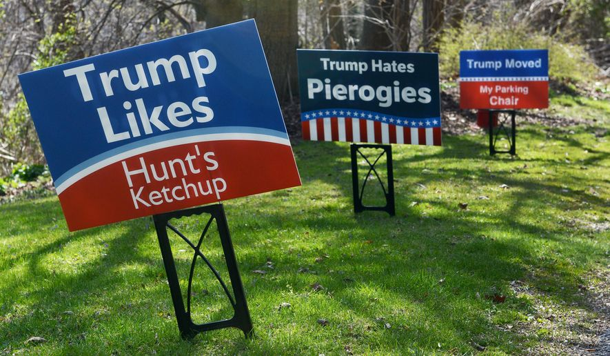 In this April 12, 2016 photo, humorous anti-Donald Trump campaign signs are displayed on Dr. Eric Rickin's yard, in Fox Chapel, Pa. Rickin decided to speak out against Trump's Pittsburgh campaign stop with some Pittsburgh-style digs, including Heinz ketchup and using chairs to save on-street parking spaces. (Michael Henninger /Pittsburgh Post-Gazette via AP) MAGS OUT; MONESSEN OUT; KITTANNING OUT; CONNELLSVILLE OUT; GREENSBURG OUT; TARENTUM OUT; NORTH HILLS NEWS RECORD OUT; BUTLER OUT; MANDATORY CREDIT