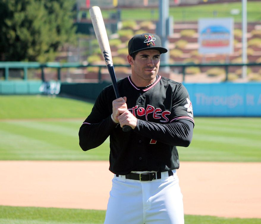 This photo taken April 4, 2016, shows Stephen Cardullo, an outfielder with the Albuquerque Isotopes, surveying his surroundings at Isotopes Park for the team's Media Day. Cardullo, 28, joins the Colorado Rockies' Triple-A farm club after four years playing independent baseball. Perseverance and gumption have marked Cardullo's career since his days as a walk-on at Florida State.  (Dave Kavanaugh/The Daily Optic via AP)