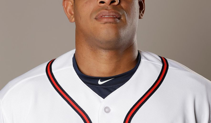 In this photo taken Feb. 26, 2016 photo, Hector Olivera of the Atlanta Braves baseball team., in Kissimmee, Fla. Police have arrested Atlanta Braves outfielder Hector Olivera after a woman accused him of assault at a hotel in Arlington, Va.  (AP Photo/John Raoux)