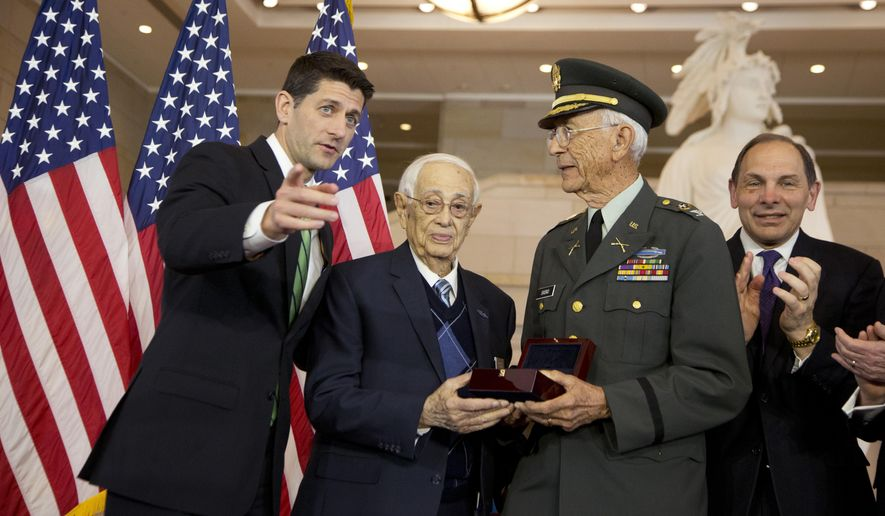 House Speaker Paul Ryan of Wisconsin, from left, presents a Congressional Gold Medal to Sgt. Maj. Jose Colon and Col. Manuel Siverio Sr., in honor of the 65th Infantry Regiment - known as the Borinqueneers - for its pioneering military service, devotion to duty, and many acts of valor in the face of adversity, during a ceremony  on Capitol Hill, in Washington, Wednesday, April 13, 2016. Witnessing the ceremony is Veterans Affairs Secretary Robert McDonald.  (AP Photo/Manuel Balce Ceneta)