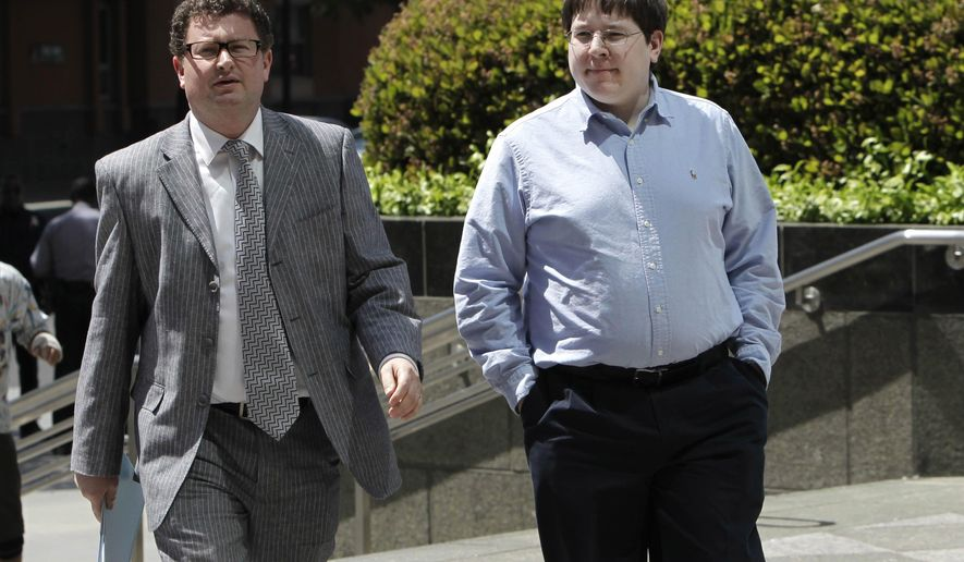 FILE -- In this April 23, 2013 file photo, Matthew Keys, right, walks to the federal courthouse for his arraignment with his attorney Jason Leiderman, in Sacramento, Calif.  Keys, a well-known social media journalist is set for sentencing Wednesday, April 13, 2016, after he was convicted of conspiring with the hacking group Anonymous to break into the Los Angeles Times' website and alter a story. Federal prosecutors in Sacramento say that despite his news media role, Keys was simply a disgruntled employee striking back at his former employer. (AP Photo/Rich Pedroncelli,file)