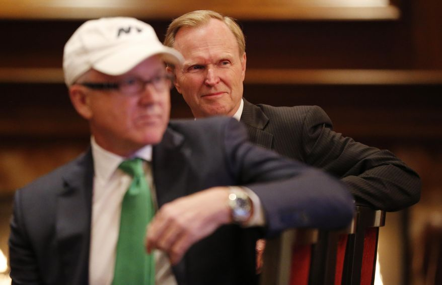 New York Giants owner John Mara, background, sits next to New York Jets owner Woody Johnson, front, while they watch a video presentation announcing a concert by Paul McCartney at MetLife Stadium, Wednesday, April 13, 2016, in East Rutherford, N.J. The concert is scheduled for Aug. 7. (AP Photo/Julio Cortez)