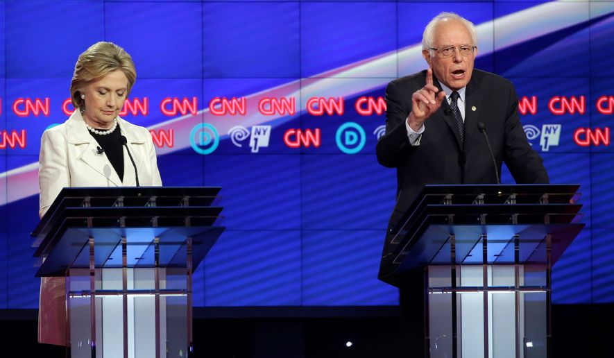 """""""When this campaign began, I said that we've got to end the starvation minimum wage of $7 and a quarter, raise it to $15,"""" Sen. Bernard Sanders said at a Democratic presidential debate in Brooklyn. """"Secretary Clinton said, 'Raise it to $12.' There's a difference. What has happened is history has outpaced Secretary Clinton because all over this country people are standing up and saying $12 is not good enough."""" (Associated Press)"""