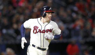 Atlanta Braves first baseman Freddie Freeman (5) runs to first in the third inning of a baseball game against the St. Louis Cardinals, Saturday, April 9, 2016, in Atlanta. (AP Photo/Brett Davis)