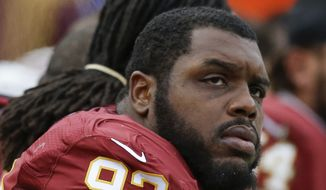 Washington Redskins defensive end Chris Baker (92) watches the action from the bench during the second half of an NFL football game against the Buffalo Bills in Landover, Md., Sunday, Dec. 20, 2015. (AP Photo/Jacquelyn Martin) **FILE**