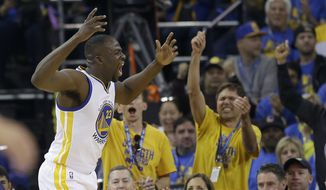 Golden State Warriors forward Draymond Green reacts in front of fans during the first half of an NBA basketball game against the Memphis Grizzlies in Oakland, Calif., Wednesday, April 13, 2016. (AP Photo/Marcio Jose Sanchez)