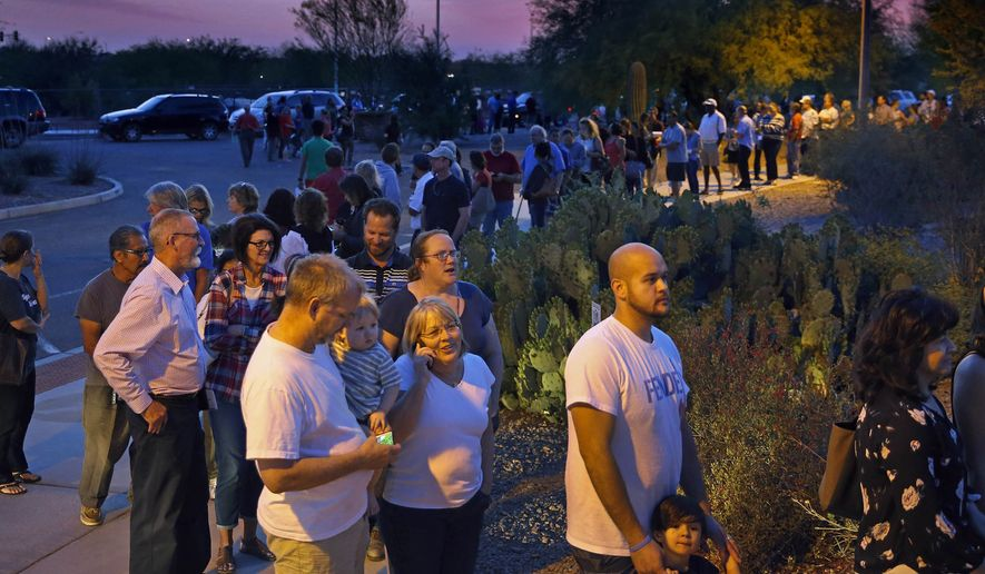 The complaints stem from the March 22 presidential primary which produced several complaints about long lines and misregistered voters that the Democrats blame on the Republican-dominated legislature trimming the number of polling places. (The Arizona Republic via Associated Press)