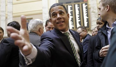 FILE - In this Jan. 14, 2015 file photo, Outgoing Maryland Lt. Gov. Anthony Brown greets members of the House of Delegates in Annapolis, Md., the first day of the 2015 legislative session. Eighteen months after he surprisingly lost his bid for the state's highest office, a safely Democratic seat in Congress will be no easy consolation prize for Brown, who is locked in a tough three-way battle. (AP Photo/Patrick Semansky, File)