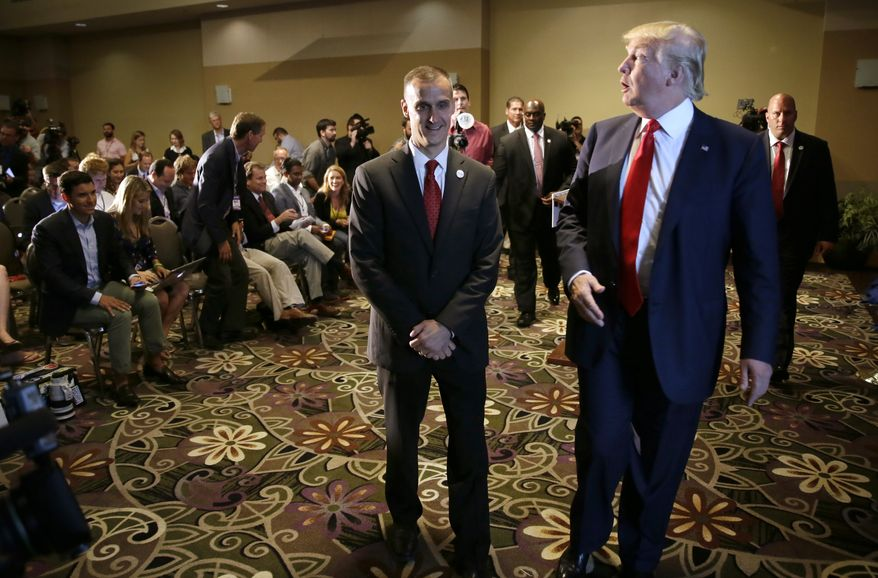 In this Aug. 25, 2015, file photo, Republican presidential candidate Donald Trump, right, walks with his campaign manager Corey Lewandowski after speaking at a news conference in Dubuque, Iowa. (AP Photo/Charlie Neibergall, File)