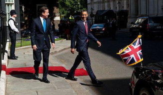 President Barack Obama and British Prime Minister David Cameron depart 10 Downing Street on their way to meet with students at Globe Academy in London, England, May 24, 2011. (Official White House Photo by Pete Souza.)