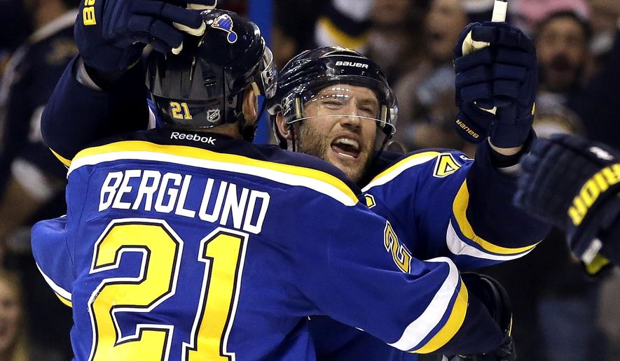 St. Louis Blues' David Backes, right, is congratulated by Patrik Berglund, of Sweden, after scoring during overtime in Game 1 of an NHL hockey first-round Stanley Cup playoff series against the Chicago Blackhawks on Wednesday, April 13, 2016, in St. Louis. The Blues won 1-0. (AP Photo/Jeff Roberson)