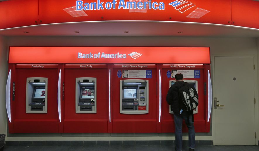 FILE - In this Dec. 13, 2012 file photo, a customer stops at a Bank of America ATM office in Boston.  Big banks aren't banking much in the way of profits. Energy loans turning bad, low interest rates and volatile markets are dragging down first quarter results for the nation's biggest banks and making the financial sector the worst performing part of the stock market. (AP Photo/Charles Krupa)