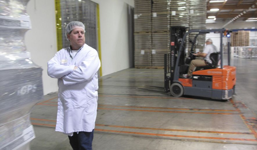 In this Wednesday, April 13, 2016 photo Todd Crosswell, general manager of Caro Nut Co. is seen at the company's nut processing plant in Fresno, Calif. Sophisticated thieves stole six truckloads from Caro Nut last year at a loss of $1.2 million to the firm. The scheme has cost the California nut industry nearly $7.6 million dollars in the last four years. In some cases, the thieves with international ties use fake shipping papers to assume the identity of legitimate firms to steal truckloads worth between $150,000 and $500,000 each. (AP Photo/Scott Smith)