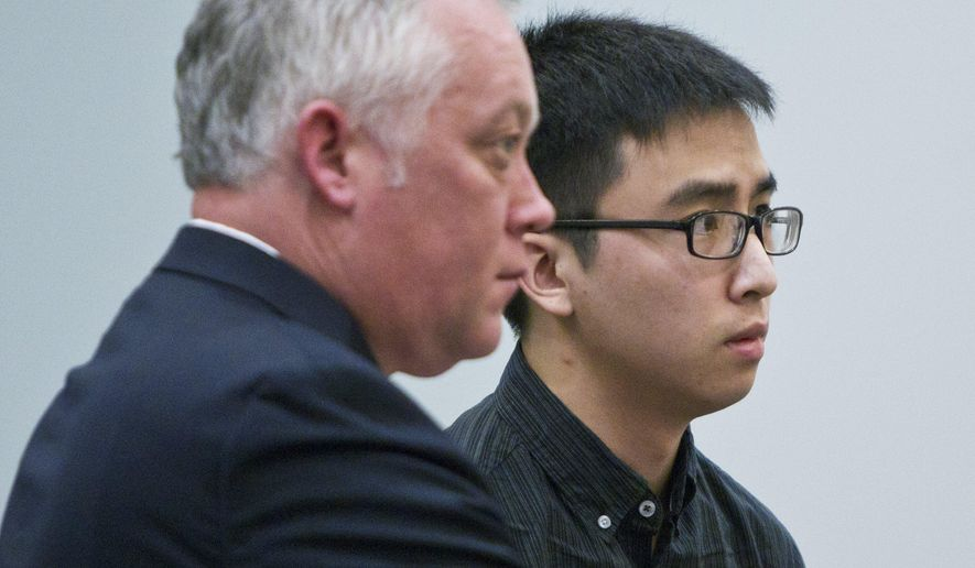 Joseph Hoai Nguyen, right, appears for his sentencing with defense attorney, Brett Stevenson, at the Kent County Courthouse in downtown Grand Rapids, Mich., Wednesday, April 13, 2016. Joseph Nguyen pleaded guilty to involuntary manslaughter in the death of his 5-month-old nephew, Isaiah Nguyen.  (Cory Morse/The Grand Rapids Press via AP) ALL LOCAL TELEVISION OUT; LOCAL TELEVISION INTERNET OUT; MANDATORY CREDIT