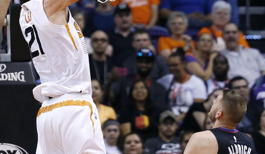 Phoenix Suns' Alex Len (21) dunks as Los Angeles Clippers' Cole Aldrich (45) watches during the first half of an NBA basketball game Wednesday, April 13, 2016, in Phoenix. (AP Photo/Ross D. Franklin)