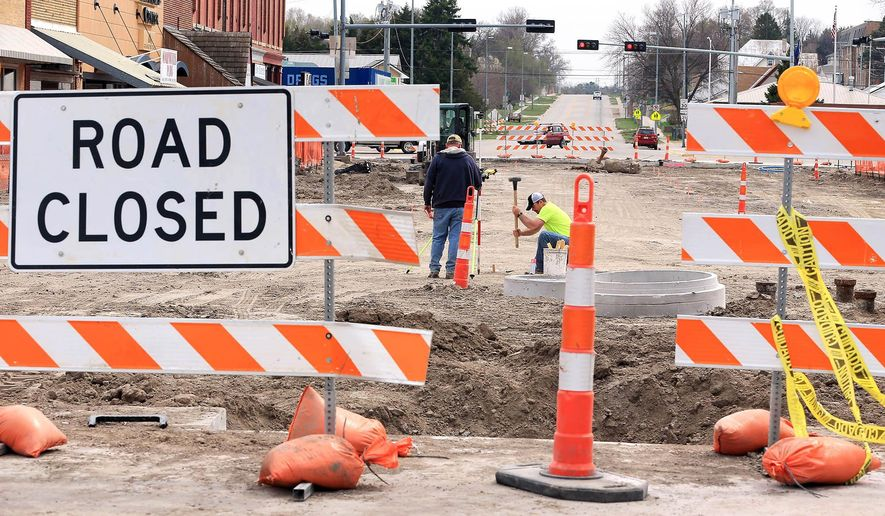In this April 5, 2016 photo, Myers Construction employees work in Broken Bow, Neb. The street is part of a large downtown improvements project underway in Broken Bow. (Barrett Stinson/The Independent via AP) MANDATORY CREDIT