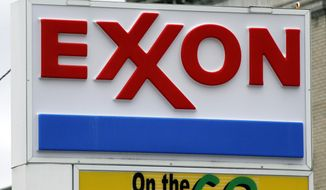 An Exxon sign at a mini-mart in Dormont, Pa.  Exxon Mobil Corp. is fighting against government investigators who believe the company covered up knowledge of how fossil fuels contribute to climate change in this April 29, 2014 file photo. Exxon went to state court in Texas on Wednesday, April 13, 2016, to seek to quash a subpoena issued last month by the attorney general of the U.S. Virgin Islands. The company says the investigation violates its constitutional rights to speak freely and to be protected from unreasonable searches and seizures.(AP Photo/Gene J. Puskar, File)