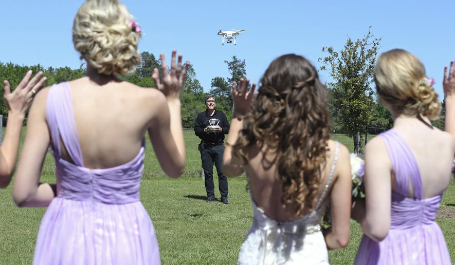 In this photo taken Saturday, April 2, 2016, drone videographer and photographer Coleman Jennings flies his drone for video footage before Taylor Jolly and Amy Stark's wedding at the Ranch House Chapel & Lodge in Montgomery, Texas. As weddings become ever more elaborate and staged, couples increasingly are demanding Hollywood-style special effects for that one-of-a-kind, jaw-dropping video. (Edward A. Ornelas/The San Antonio Express-News via AP) RUMBO DE SAN ANTONIO OUT; NO SALES; MANDATORY CREDIT