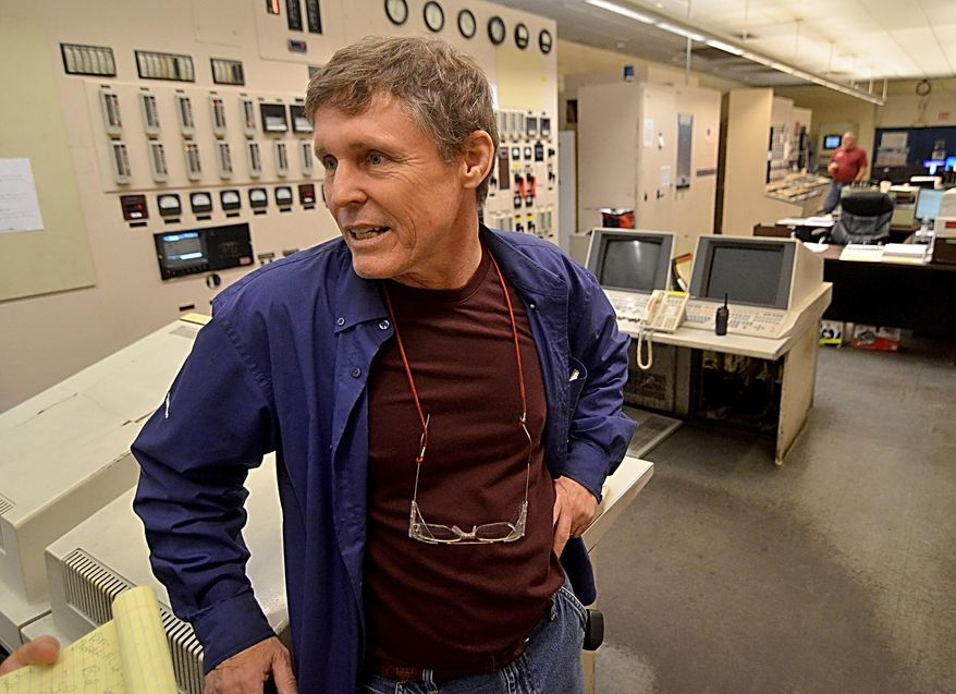 In this photo taken Tuesday April 12, 2016, Duke Energy Wabash River Generating Station employee Bud Bays talks about some of the unique things he has seen during his 36 years while speaking at the station's control room at the plant north of Terre Haute, Ind. After 63 years, Duke Energy's Wabash River Generating Station has ceased to produce power. The station's last official day to burn coal is Friday, April 14, 2016, but power producing units on Tuesday were already shut down. (Joseph C. Garza/The Tribune-Star via AP) MANDATORY CREDIT