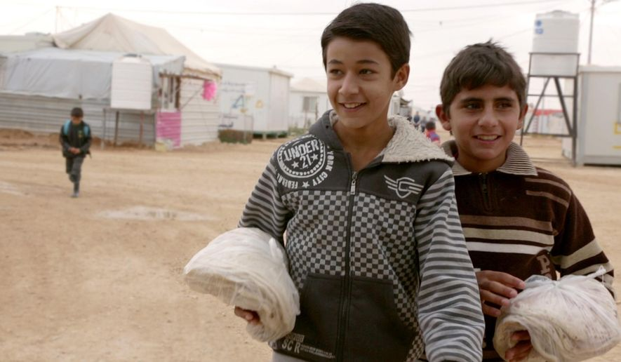 """This image released by the Tribeca Film Festival shows a scene from """"After Spring,"""" a film about the Syrian refugee crisis. The film will be shown at the Tribeca Film Festival, kicking off Wednesday, April 13. (Tribeca Film Festival via AP)"""