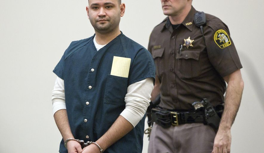 Juan Reyes, left, appears for his sentencing at the Kent County Courthouse in downtown Grand Rapids, Mich., Wednesday, April 13, 2016. Reyes, who fled to Mexico after the 2007 shooting death of an innocent bystander, Douglas Pollok, was found guilty of second-degree murder. (Cory Morse/The Grand Rapids Press via AP) ALL LOCAL TELEVISION OUT; LOCAL TELEVISION INTERNET OUT; MANDATORY CREDIT