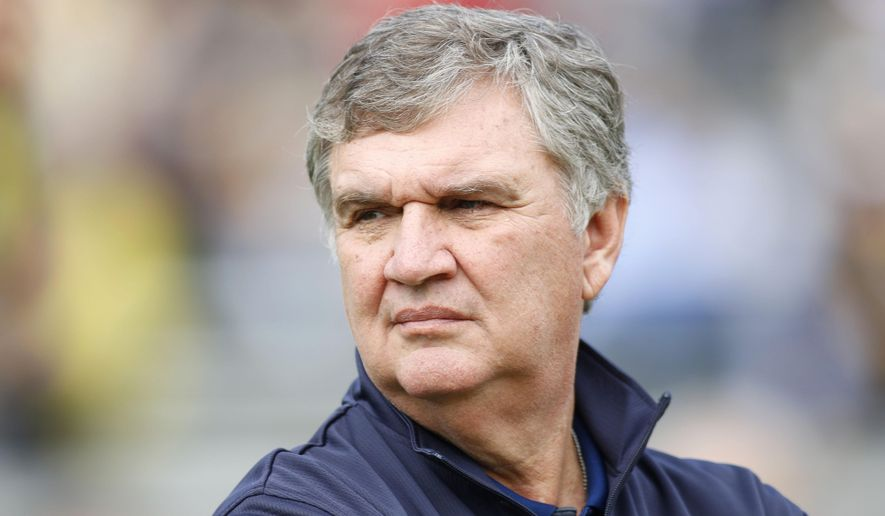 FILE - In this Nov. 28, 2015 file photo, Georgia Tech head coach Paul Johnson prepares for a game against Georgia in an NCAA college football game in Atlanta. Georgia Tech is shuffling personnel on the offensive line, welcoming A-back Qua Searcy's return from a season-ending ankle injury and trying out TaQuon Marshall as the the No. 2 quarterback behind Justin Thomas. It's a busy spring for coach Paul Johnson. (AP Photo/Brett Davis, File)