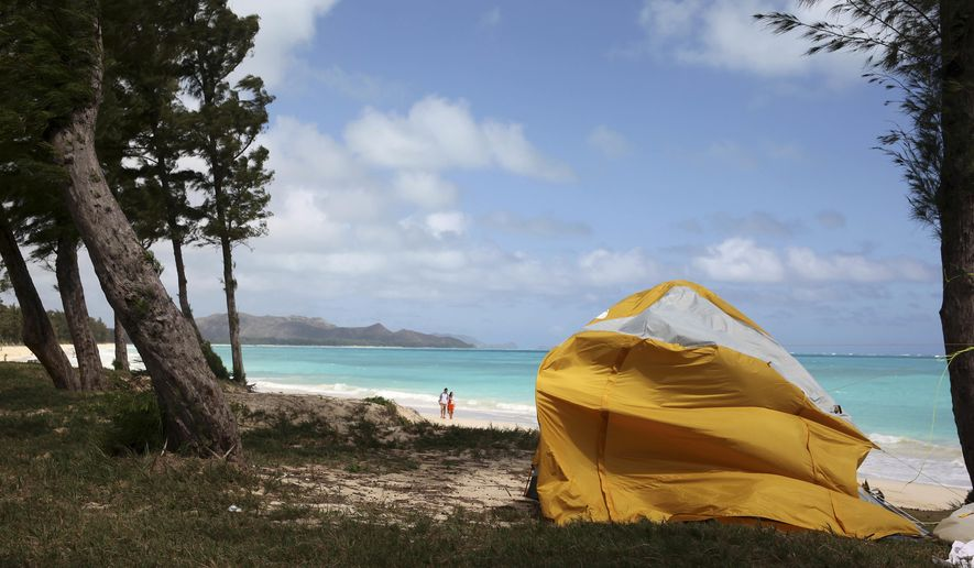 A tent sits on Waimanalo Beach, one of the state's world-class beaches, in Waimanalo, Hawaii on Thursday, April 14, 2016. A bill is being considered by Hawaii lawmakers this session to crack down on a growing market in the state: vacation rental brokers who offer up tents to tourists on the islands beaches and public parks. (AP Photo/Marina Riker)